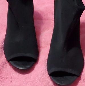 Black open-toe booties w/ back zipper.